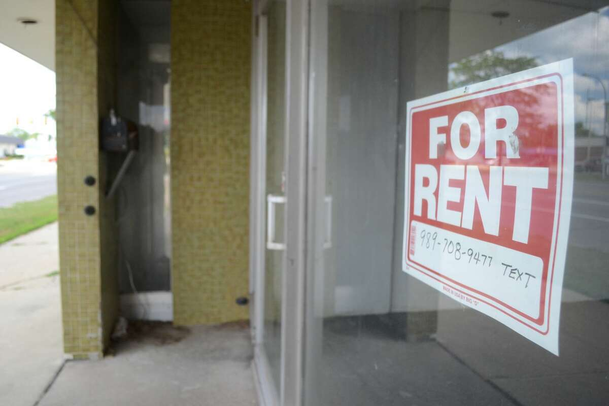 FILE - A For Rent sign is posted in a former Ashman Circle storefront.