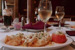 This red snapper with crabmeat at Ernesto's is topped with a jicama butter sauce and served with a broiled tomato.