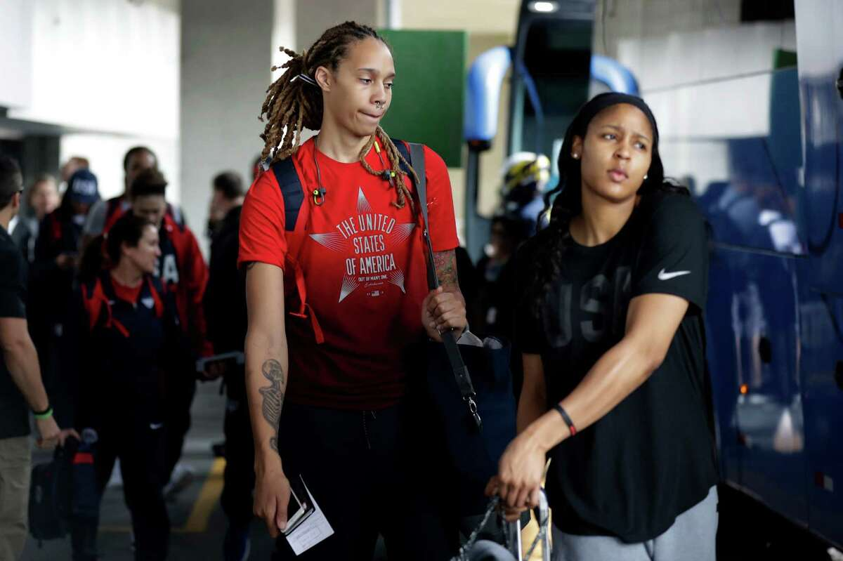United States women's basketball players Brittney Griner, left, and Maya Moore, right, board a bus at the airport after arriving at the 2016 Summer Olympics in Rio de Janeiro, Brazil, Wednesday, Aug. 3, 2016. (AP Photo/Charlie Neibergall)