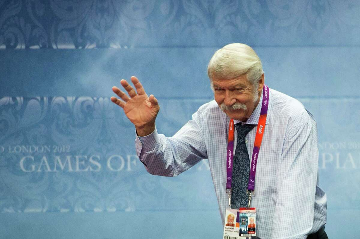 Bela Karolyi waves to the crowd from a broadcast booth during the women's gymnastics team finals at the 2012 London Olympics on Tuesday, July 31, 2012. ( Smiley N. Pool / Houston Chronicle )