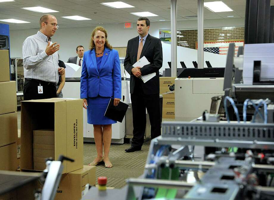 Congresswoman Elizabeth Esty, center, tours Pitney Bowes in Danbury,  Monday, August 1, 2016. Left is Eddy Edel, a vice president, and right is Jason Dies, president of Pitney Bowes Document Messaging Technologies. Photo: Carol Kaliff / Hearst Connecticut Media / The News-Times