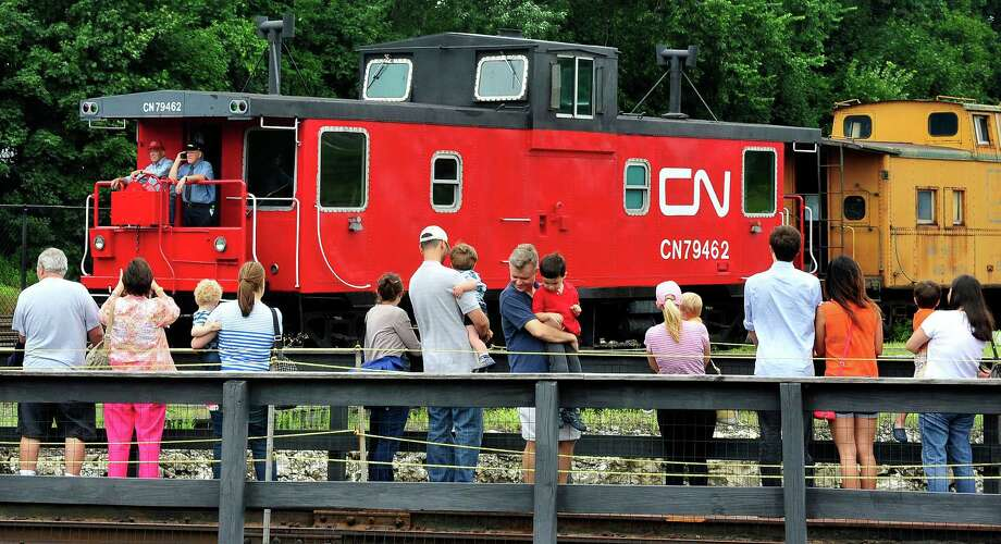 Visitors rotate on Connecticut's only power-operated turntable as a special caboose train passes as during Danbury Railway Day at the Danbury Railway Museum, Saturday Aug. 3, 2013, in Danbury. Photo: Michael Duffy / Michael Duffy / The News-Times