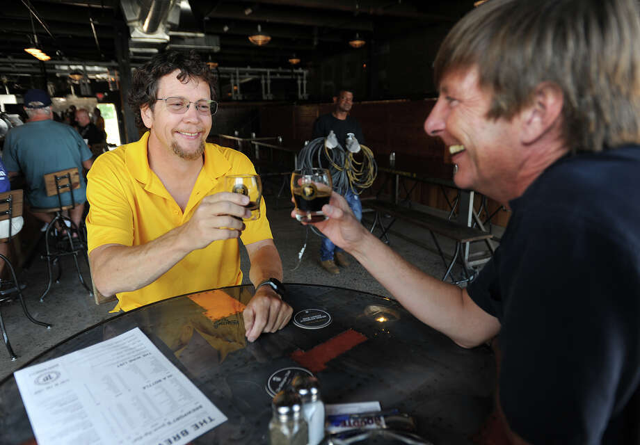 Partners Jeff Browning, left, and Bruce Barrett enjoy a beer during their first day opening at the new Brewport Brewing Co. at 225 South Frontage Road in Bridgeport, Conn. on Monday, August 1, 2016. Photo: Brian A. Pounds / Hearst Connecticut Media / Connecticut Post