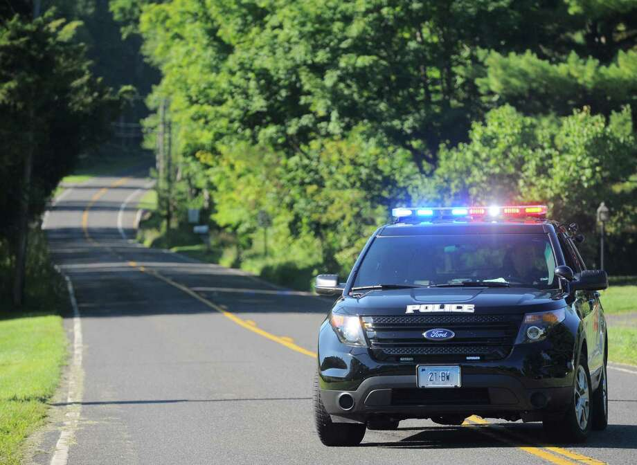 Local police close off Rte 133 at the intersection of Main Street S ( Rte 133) and Stuart Road E and Stuart Road W, in Bridgewater. Main Street S was close traffic because of an investigation into a reported shooting and home invasion early Thursday morning. August, 4, 2016, in Bridgewater, Conn. Rte 133 is also closed to thru traffic because of scheduled construction. Photo: H John Voorhees III / Hearst Connecticut Media / The News-Times