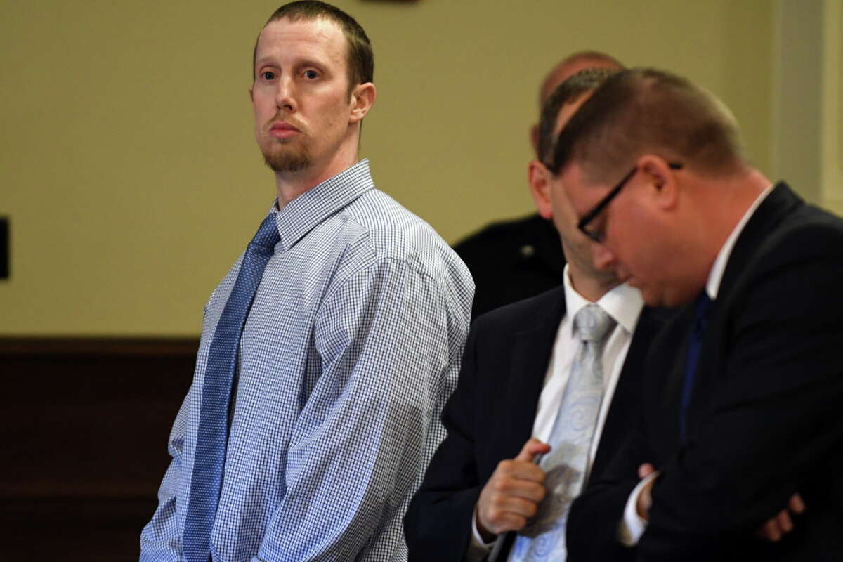 Jacob Heimroth, left, with attorneys Trevor Hannigan and Joe Ahearn during opening statements in his trial for murder at Rensselaer County Court on Tuesday Aug. 2, 2016 in Troy, N.Y. (Michael P. Farrell/Times Union)