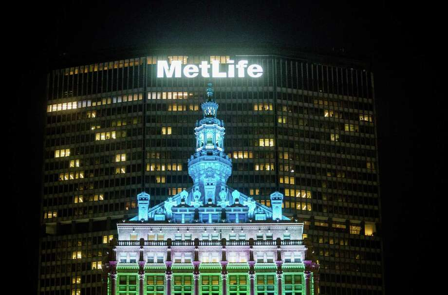 MetLife said second-quarter profit tumbled 90 percent to $110 million. Central bank policies to suppress interest rates have reduced the income MetLife makes on a bond-dominated investment portfolio valued at more than $500 billion. Photo: Michael Nagle /Bloomberg News / © 2016 Bloomberg Finance LP