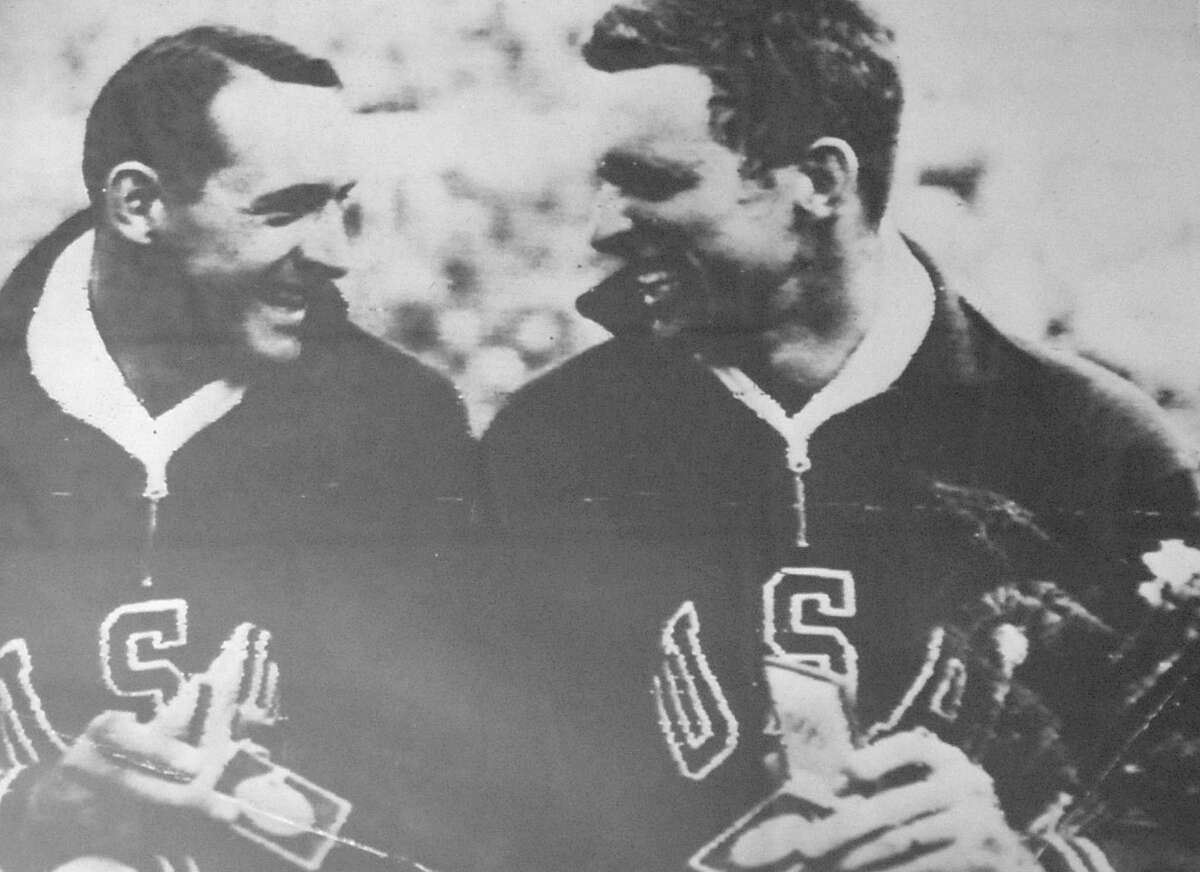 This enlarged photograph of Walter Davis, right, and a teammate, after they both won medals, was hanging in the home office. Walter F.