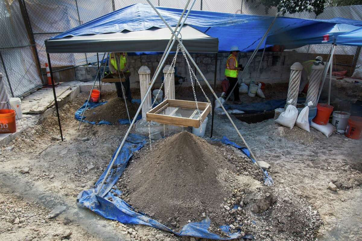 Archeologist work on one of two sites following a briefing on the current status of a new archeological dig at The Alamo in San Antonio, on Thursday, August 4, 2016. The project seeks to discover additional boundary lines and walls that will contribute to The Alamo's overall historical narrative.
