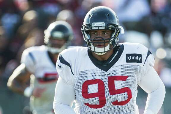 Houston Texans defensive tackle Christian Covington (95) jogs across the field to the next drill during Texans training camp at Houston Methodist Training Center on Thursday, Aug. 4, 2016, in Houston.