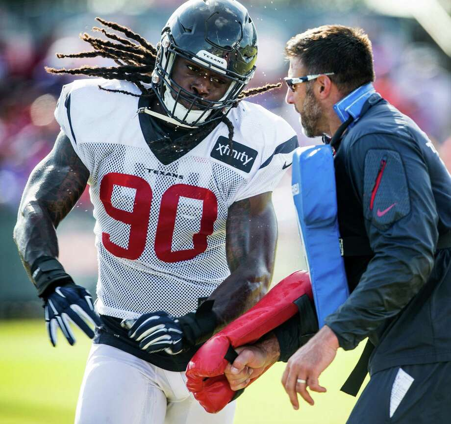 Former Texans defensive coordinator and current Titans head coach Mike Vrabel (right) said it takes varying amount of time for players like Jadeveon Clowney to learn linebacker in the NFL after playing defensive end in college. Photo: Brett Coomer, Houston Chronicle / © 2016 Houston Chronicle