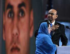 "(FILES) This file photo taken on July 28, 2016 shows Khizr Khan, father of Humayun S. M. Khan  who was killed while serving in Iraq with the US Army, gestures as his wife looks on during the fourth and final day of the Democratic National Convention at the Wells Fargo Centerin Philadelphia, Pennsylvania.   The father of a slain Muslim American soldier assailed Donald Trump as a ""black soul"" July 31, 2016 in an impassioned exchange with the Republican presidential candidate over the qualities required in a US leader. Khizr Khan electrified the Democratic convention last week with a tribute to his fallen son that ended with a steely rebuke that Trump had ""sacrificed nothing"" for his country.  / AFP PHOTO / Timothy A. CLARYTIMOTHY A. CLARY/AFP/Getty Images"