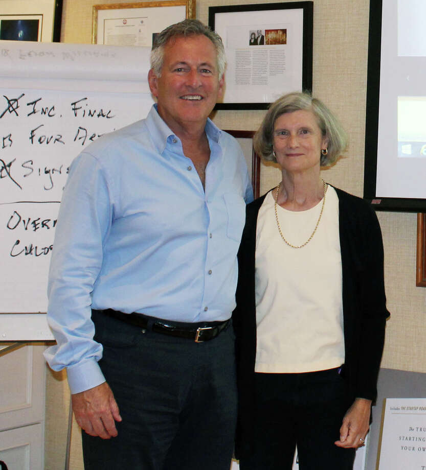 "Ed McLaughlin and Wyn Lydecker in the office in Darien where they wrote their book ""The Purpose is Profit."" Photo: Erin Kayata / Hearst Connecticut Media / Darien News"