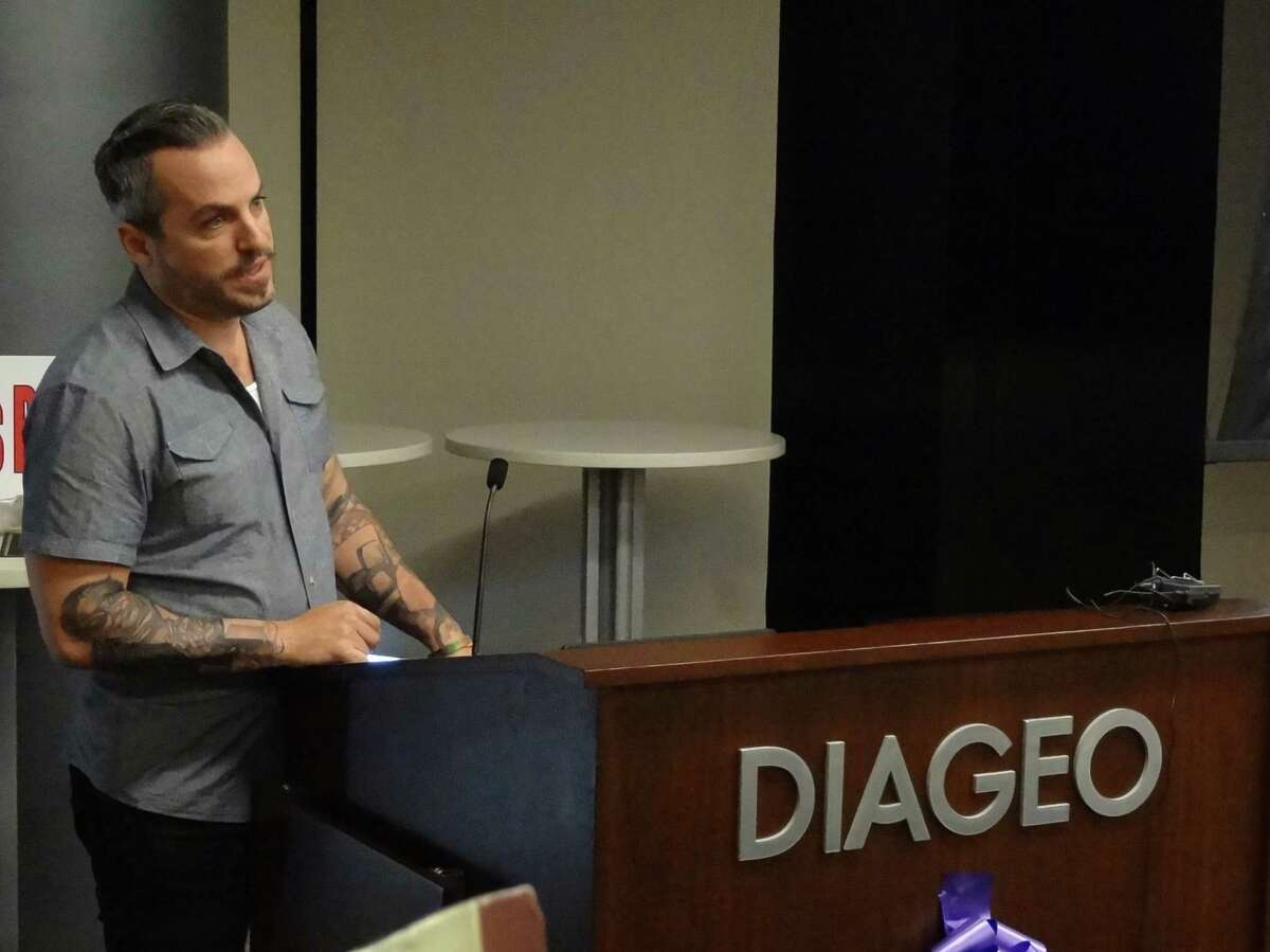 Tim Cabral, owner of the New Haven tavern Ordinary, speaks in Norwalk, Conn. on August 3, 2016 at the headquarters of Diageo North America. Diageo held a ceremony for 18 graduates of its
