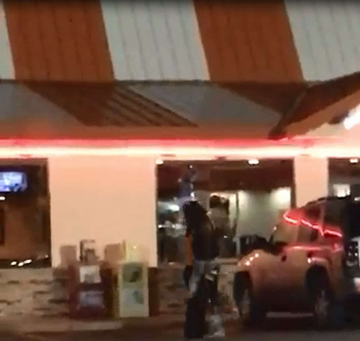 An employee at a Whataburger in Tyler, Texas was reportedly fired after she was caught on video engaging in a fight in the restaurant parking lot Friday, July 29, 2016.
