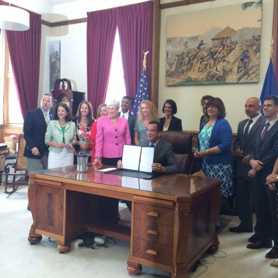From left: CT Rep. Andrew Fleishmann, CT Rep Gail Lavielle, Maria Naughton, Dr. Kimberly Norton Butler, Lt.  Governor, Ajit Gopalakrishnan, Jennifer Jacobsen-Tapsall, CT Governor Malloy, CT Rep. Cristin McCarthy Vahey (back row), Donna Person, Pam Lucashu, Ray Rossomando, David McGuire at a ceremonial signing of Public Act 16-189 in Governor Malloy's office in Hartford, CT on July 12, 2016. Photo: Contributed Photo / Hearst Connecticut Media / New Canaan News