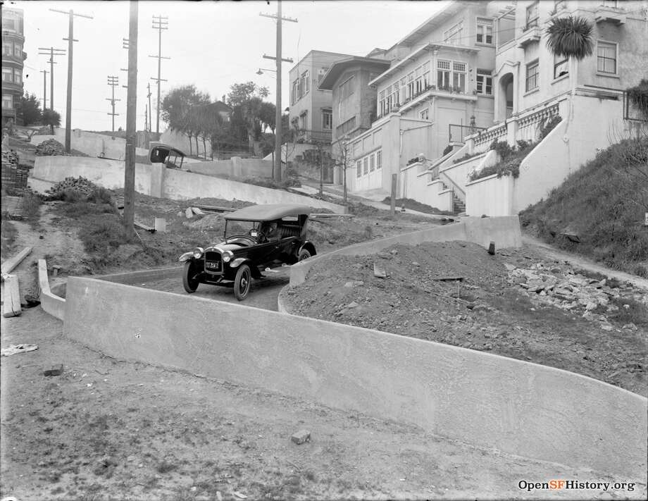 This photo from the archives shows Lombard Street construction in 1922, with the crooked street roadway completed and cars coming down. Courtesy of OpenSFHistory.org. Photo: Courtesy Of OpenSFHistory.org