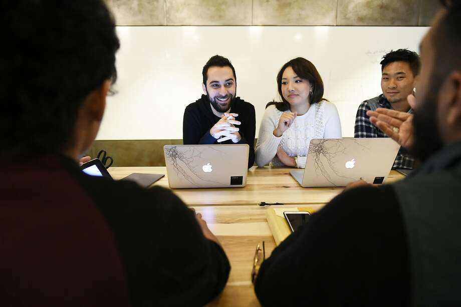 Uber product manager Chris Saad, software engineer Christine Kim and product marketer Nathan Lam meet with staff at Pythagoras Pizza, which uses the UberRush app to deliver its artisanal pizza. Photo: Michael Noble Jr., The Chronicle