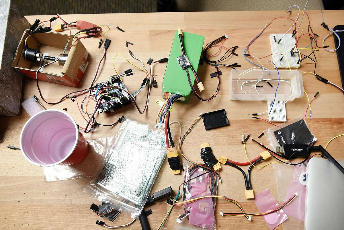 A table is littered with parts used in drone making at Sky Front's offices in Menlo Park, CA Thursday, August 4th, 2016.