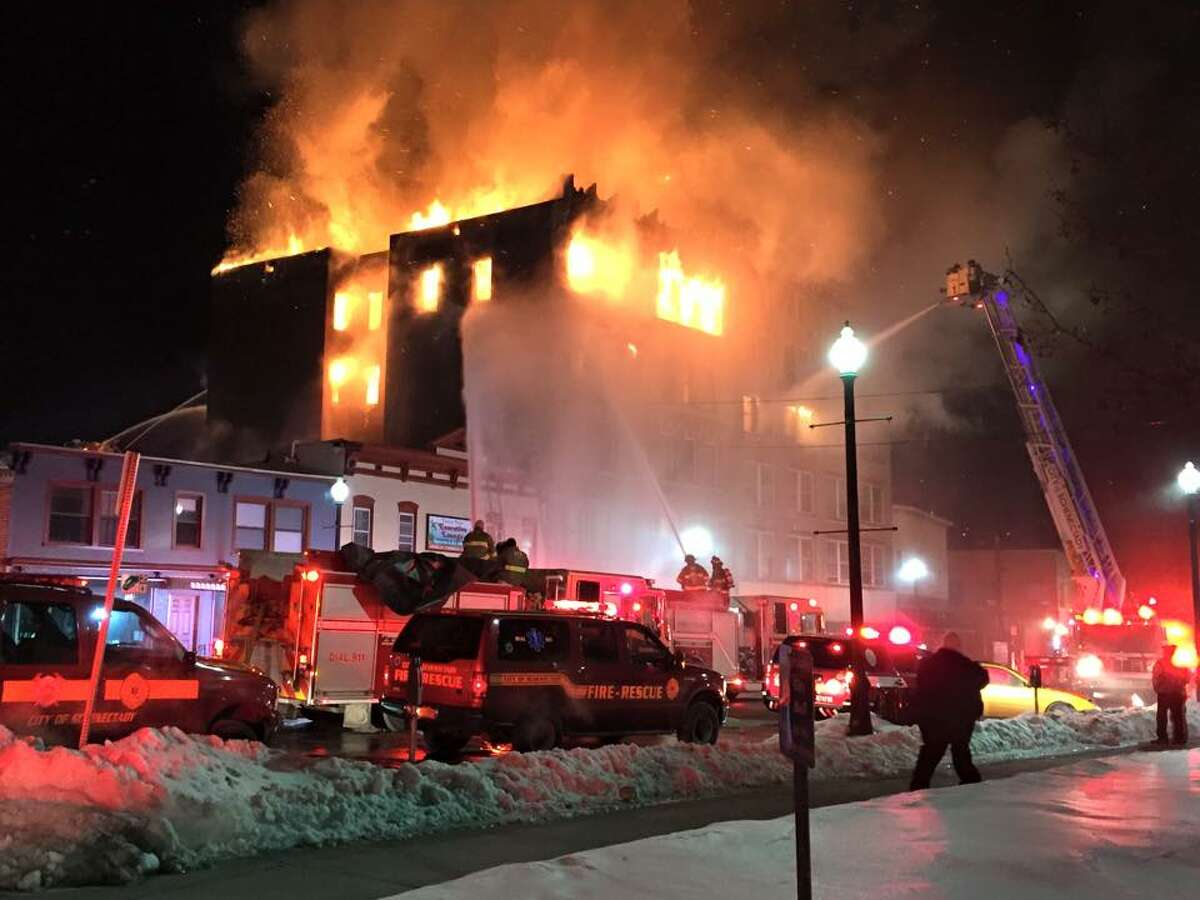 Firefighters battle a raging fire at 104 Jay St., Schenectady, in 2015. The fire damaged the building as well as a neighboring apartment building. (Jason Moskowitz / Special to the Times Union)