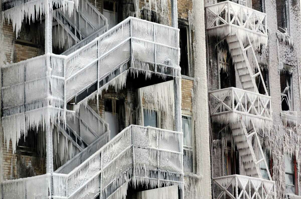 The ice covered rear fire escapes on the two fire gutted buildings on Jay Street Saturday March 7, 2015 in Schenectady, N.Y. (Michael P. Farrell/Times Union)