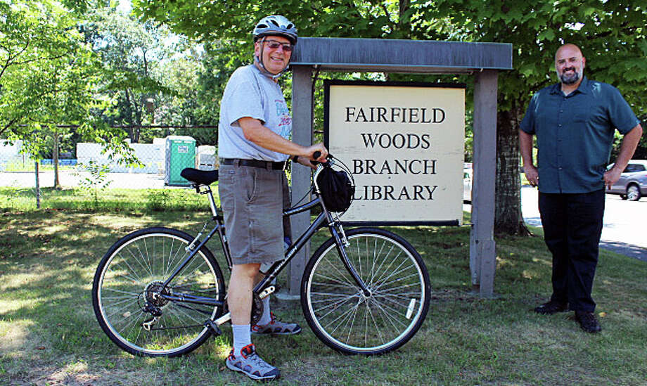 Don Hyman, left, and Keith Gallinelli, chairman of the town's Bicycle and Pedestrian Committee, at the Fairfield Woods Library, where an approved bike route runs from Fairfield Woods Road to the downtown library. Fairfield, CT. 7/27/16 Photo: Genevieve Reilly / Hearst Connecticut Media / Fairfield Citizen