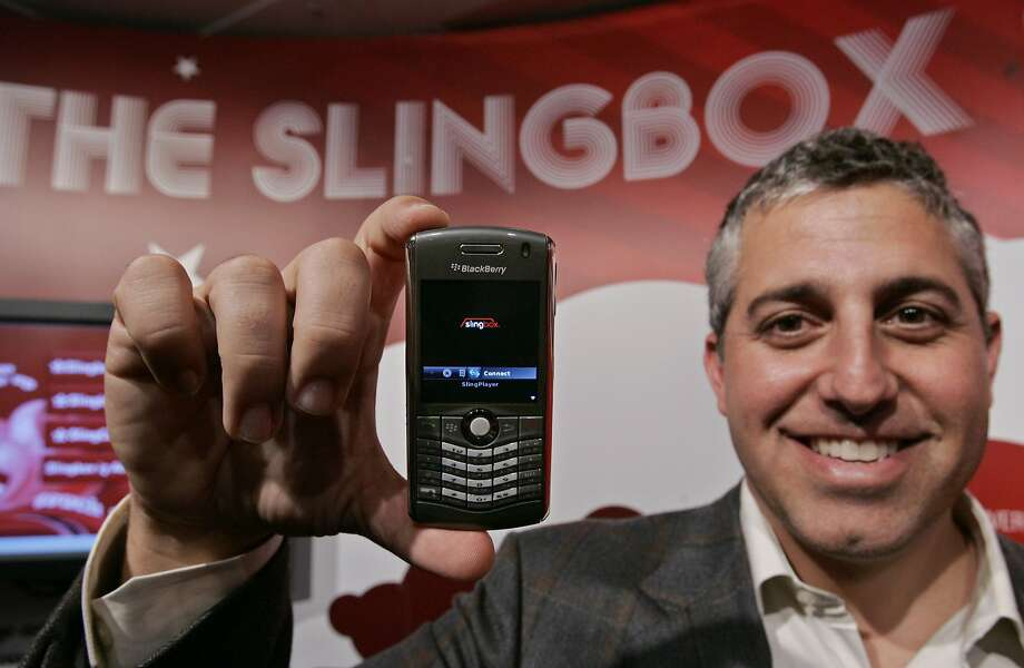Blake Krikorian displays the SlingPlayer Mobile for Black Berry at 2008's Consumer Electronics Show in Las Vegas. Photo: Paul Sakuma, AP