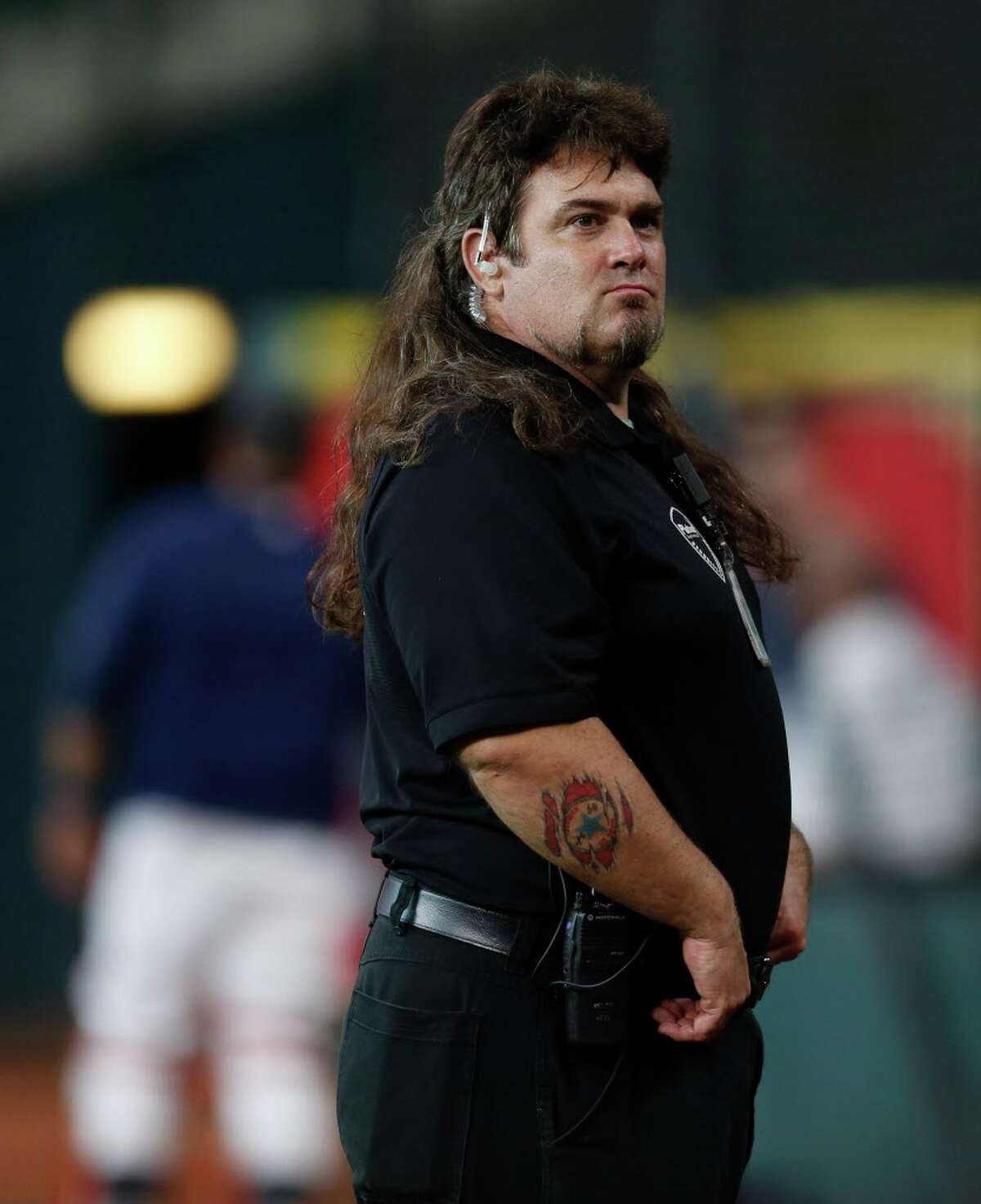 Chaz Taylor, a security guard at the Astros' batting practice before the start of a Major League Baseball game at Minute Maid Park, Tuesday, Aug. 2, 2016, in Houston. Taylor is also a wrestler. ( Karen Warren / Houston Chronicle )
