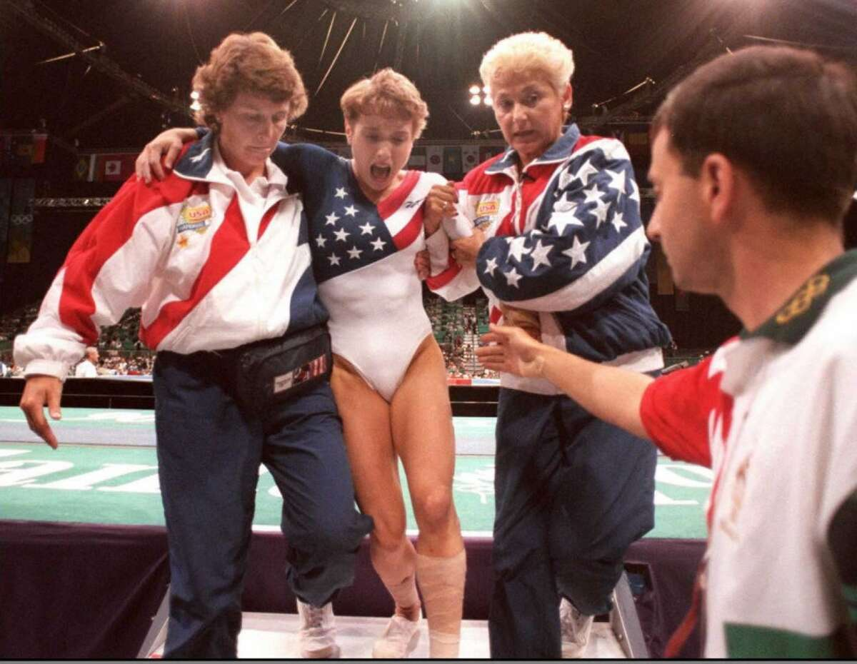 US gymnast Kerri Strug (2nd L) is pictured here, after famously injuring her ankle in the 1998 Olympics.