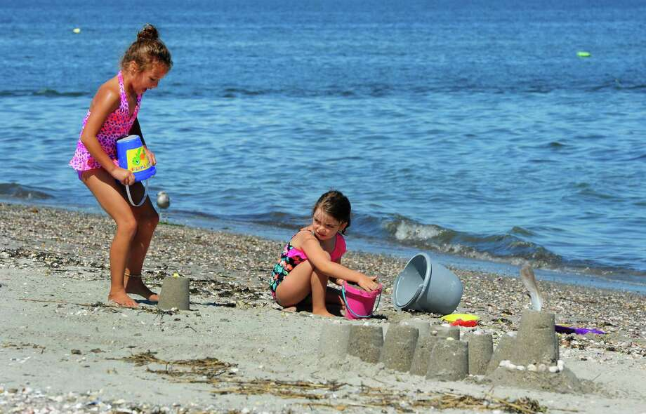 Tessa Bundy, 7, from PA and visiting family in Derby and Gabriella Plante, 6, of Seymour, play on the beach at Silver Sands State Park in Milford, Conn., on Thursday Aug. 4, 2016. Photo: Christian Abraham, Hearst Connecticut Media / Connecticut Post