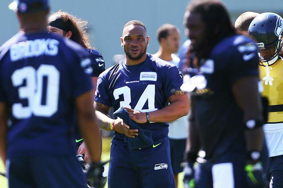 Running back Thomas Rawls (34) is on the field during day five of the Seahawks mini camp, Thursday, Aug. 4, 2016 at Virginia Mason Athletic Center. Photo: GENNA MARTIN, SEATTLEPI.COM / SEATTLEPI.COM