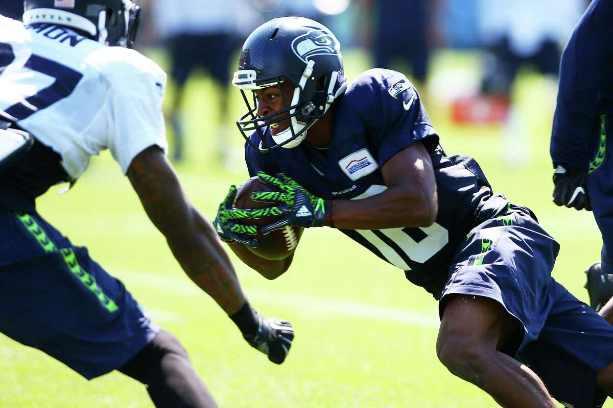 Wide receiver Tyler Lockett dives with the ball during day five of the Seahawks mini camp, Thursday, Aug. 4, 2016 at Virginia Mason Athletic Center.