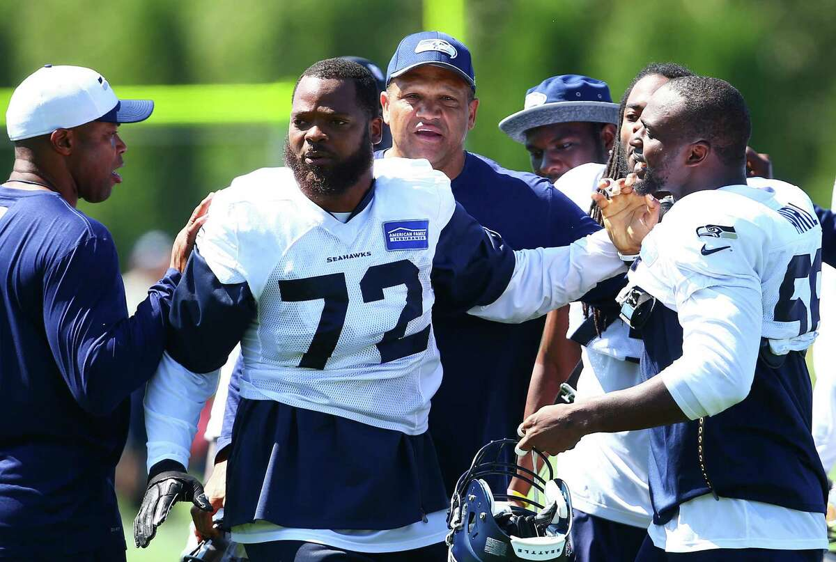 An agitated Michael Bennett (72) walks away from a scuffle he got into during day five of the Seahawks mini camp, Thursday, Aug. 4, 2016 at Virginia Mason Athletic Center.