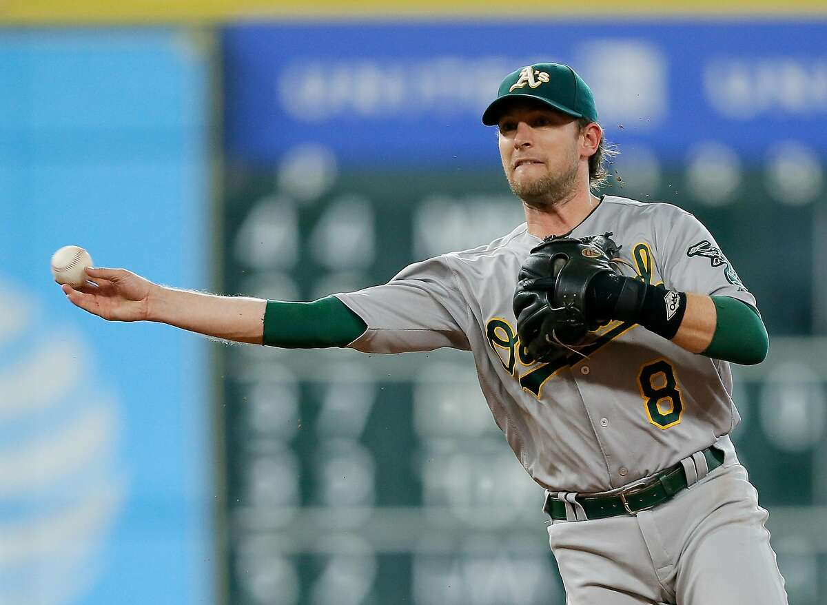 HOUSTON, TX - JULY 08: Jed Lowrie #8 of the Oakland Athletics throws to first base in the first inning against the Houston Astros at Minute Maid Park on July 8, 2016 in Houston, Texas. (Photo by Bob Levey/Getty Images)