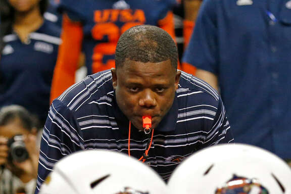 New head football coach Frank Wilson (top) focuses his eyes on to lineman squaring off during a drill at the UTSA Spring Game at the Alamodome on Saturday, Apr. 23, 2016.