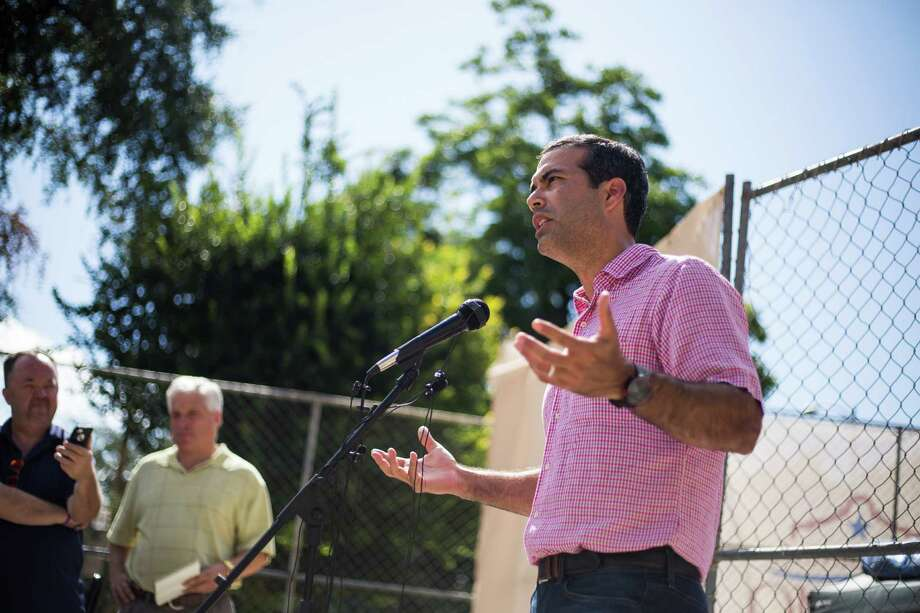 Texas Land Commissioner George P. Bush speaks during a briefing on the current status of a new archeological dig at The Alamo in San Antonio, on Thursday, August 4, 2016. The project seeks to discover additional boundary lines and walls that will contribute to The Alamo's overall historical narrative. Photo: BRITTANY GREESON, Staff / San Antonio Express-News / © 2016 San Antonio Express-News