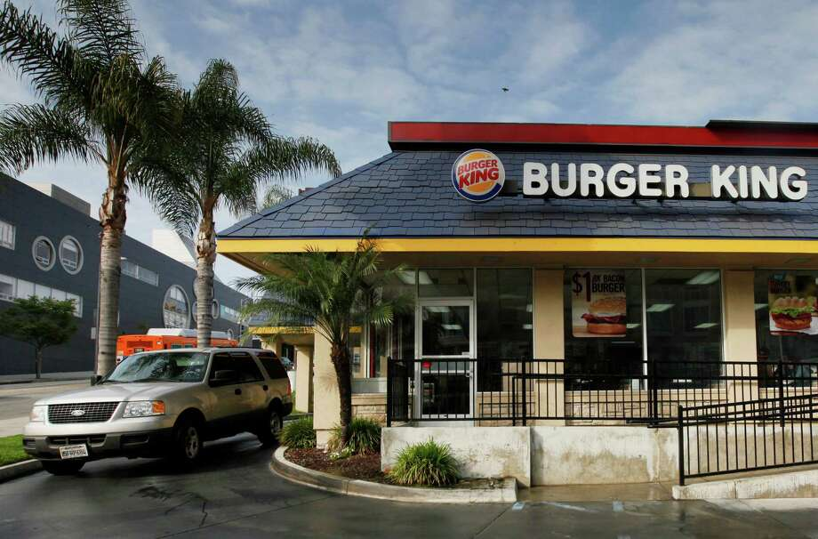 Burger King's sales slipped 0.8 percent at established restaurants in the U.S.  Photo: Nick Ut, STF / A2013