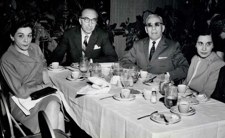 Lois DeBakey, left, and Selma DeBakey, right, joined Michael DeBakey and their father Shaker for dinner in Lake Charles, La., in this photograph from 1948. Lois, who died last month, and Selma, who died in 2013, pioneered the field of scientific communications. Photo: NIH / NIH