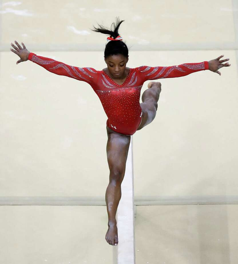 United States' Simone Biles trains on the balance beam ahead of the 2016 Summer Olympics in Rio de Janeiro, Brazil, Thursday, Aug. 4, 2016. (AP Photo/Julio Cortez) Photo: Julio Cortez, Associated Press / Copyright 2016 The Associated Press. All rights reserved. This material may not be published, broadcast, rewritten or redistribu