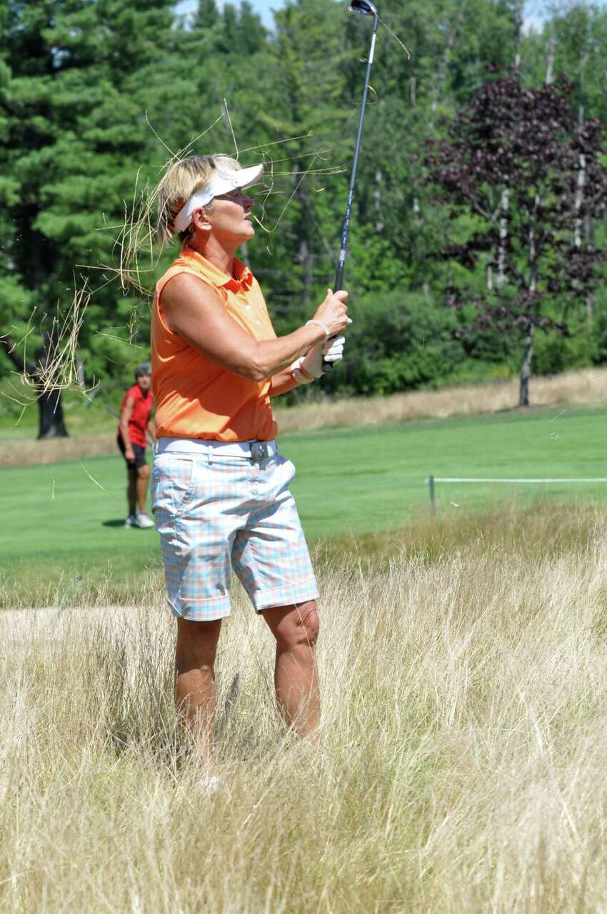 Kathy Harkins hits out of the fescue during the final round of the Northeastern Women's Golf Association championship at Ballston Spa Country Club on Thursday, Aug. 4, 2016 in Ballston Spa, N.Y. (Eliza Mineaux/Special to the Times Union)