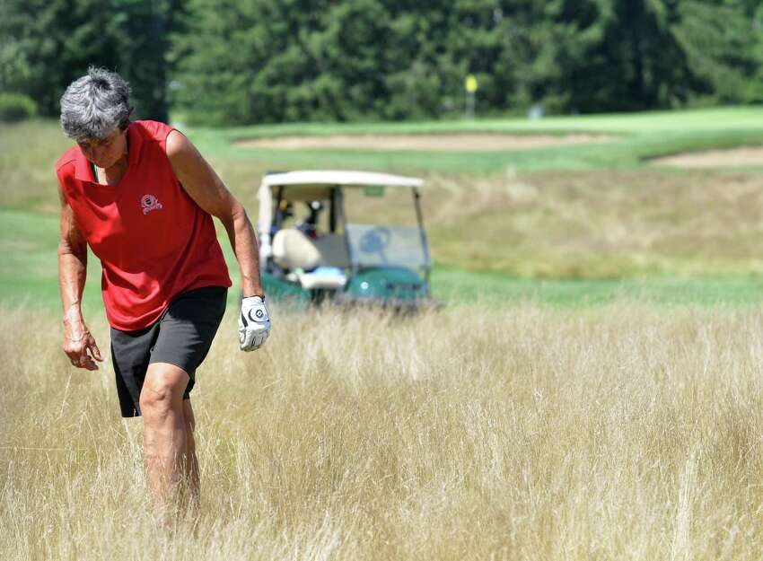 Linda Kolnick helps look for a ball in the fescue during the final round of the Northeastern Women's Golf Association championship at Ballston Spa Country Club on Thursday, Aug. 4, 2016 in Ballston Spa, N.Y. (Eliza Mineaux/Special to the Times Union)