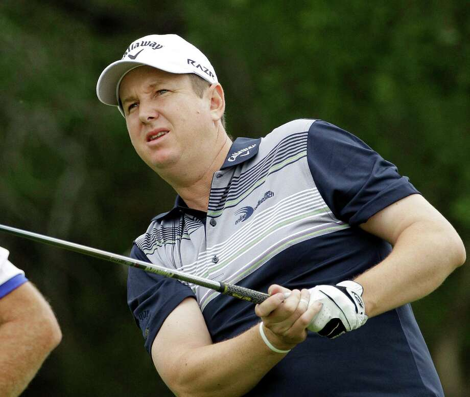 J.J. Henry of Fort Worth, Texas, watches his drive on the ninth hole during the first round of the Texas Open golf tournament, Thursday, April 14, 2011 in San Antonio. (AP Photo/Eric Gay) Photo: Eric Gay / ST / AP