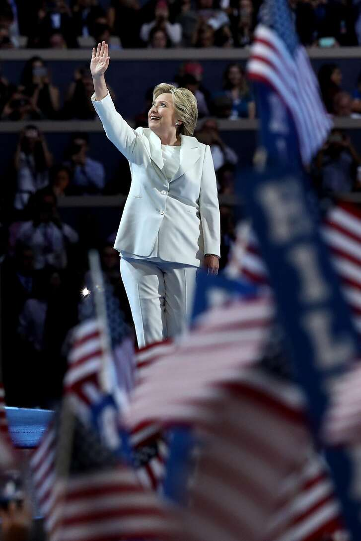PHILADELPHIA, PA - JULY 28:  Democratic presidential nominee Hillary Clinton waves to the crowd as she arrives on stage during the fourth day of the Democratic National Convention at the Wells Fargo Center, July 28, 2016 in Philadelphia, Pennsylvania. Democratic presidential candidate Hillary Clinton received the number of votes needed to secure the party's nomination. An estimated 50,000 people are expected in Philadelphia, including hundreds of protesters and members of the media. The four-day Democratic National Convention kicked off July 25.  (Photo by Jessica Kourkounis/Getty Images)
