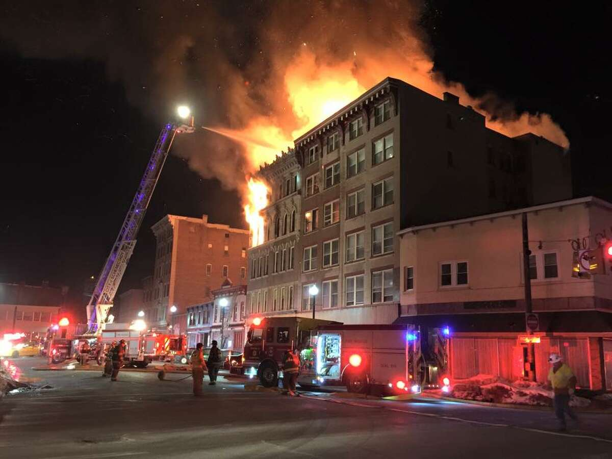 Firefighters battle a raging fire at 104 Jay St., Schenectady, early Friday. The fire damaged the building as well as a neighboring apartment building. (Jason Moskowitz / Special to the Times Union)