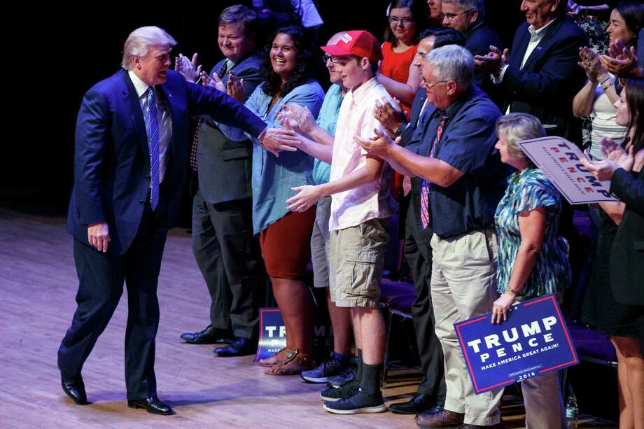 "Supporters for Donald Trump at a rally in Portland, Maine on Thursday included Gov. Paul LePage, who said the media has been ""very tough"" on Trump. Photo: Evan Vucci, STF / Copyright 2016 The Associated Press. All rights reserved. This material may not be published, broadcast, rewritten or redistribu"