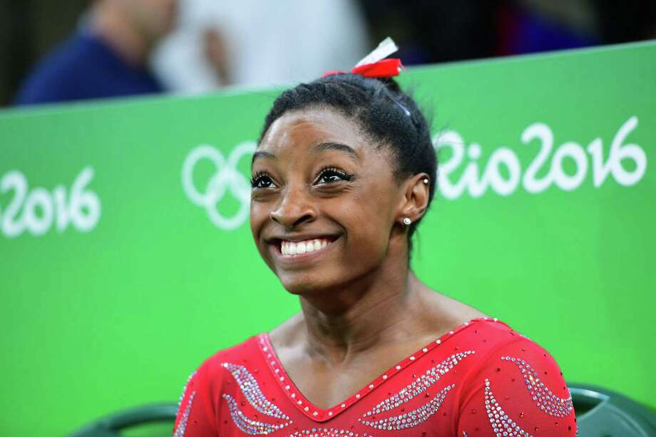 The smile of star gymnast Simone Biles will no doubt get plenty of airtime on NBC in the days ahead. Photo: EMMANUEL DUNAND, Staff / AFP or licensors