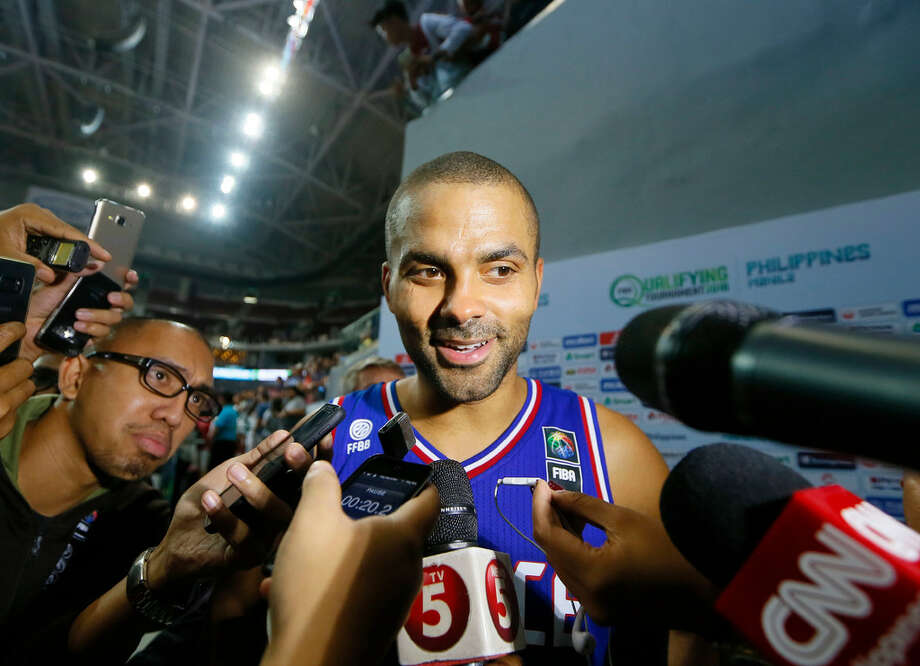 Tony Parker of France talks to the media following their 83-74 win over Canada in the finals of the FIBA Olympic Qualifying basketball match Sunday, July 10, 2016 at the Mall of Asia Arena in suburban Pasay city south of Manila, Philippines. The win qualified France for the Rio Olympics. Photo: Bullit Marquez /AP Photo