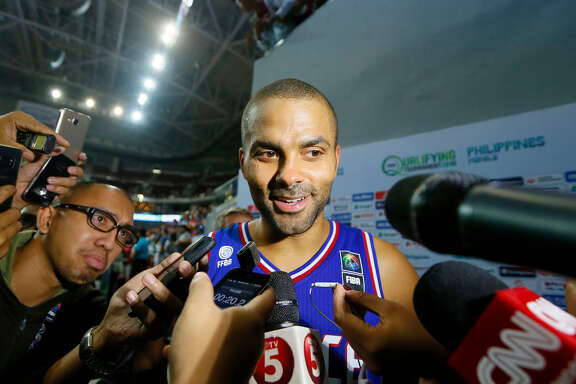 Tony Parker of France talks to the media following their 83-74 win over Canada in the finals of the FIBA Olympic Qualifying basketball match Sunday, July 10, 2016 at the Mall of Asia Arena in suburban Pasay city south of Manila, Philippines. The win qualified France for the Rio Olympics.