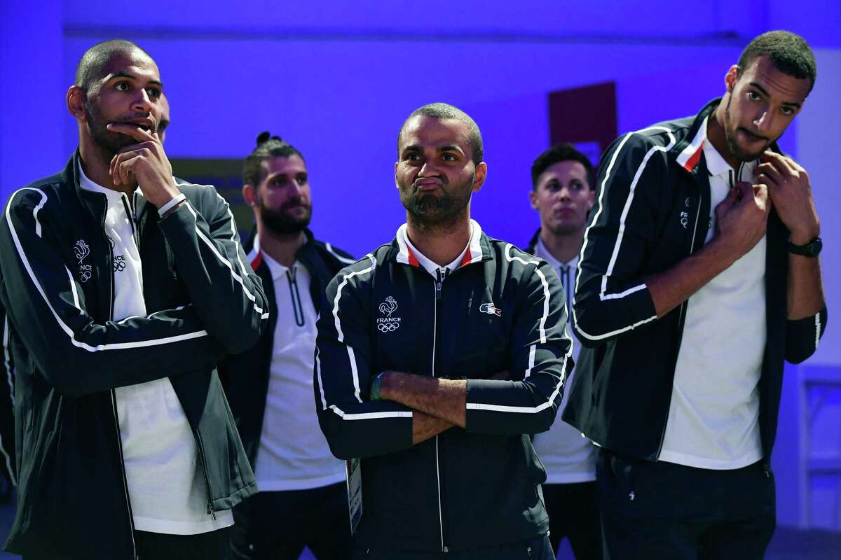 """(L to R) France's small forward Nicolas Batum, France's point guard Tony Parker and France's centre Rudy Gobert attend a press conference of the French national basketball team ahead of the Rio 2016 Olympic Games, on August 3, 2016, at the """"Club France"""" in Rio de Janeiro. / AFP PHOTO / Jeff PACHOUDJEFF PACHOUD/AFP/Getty Images"""