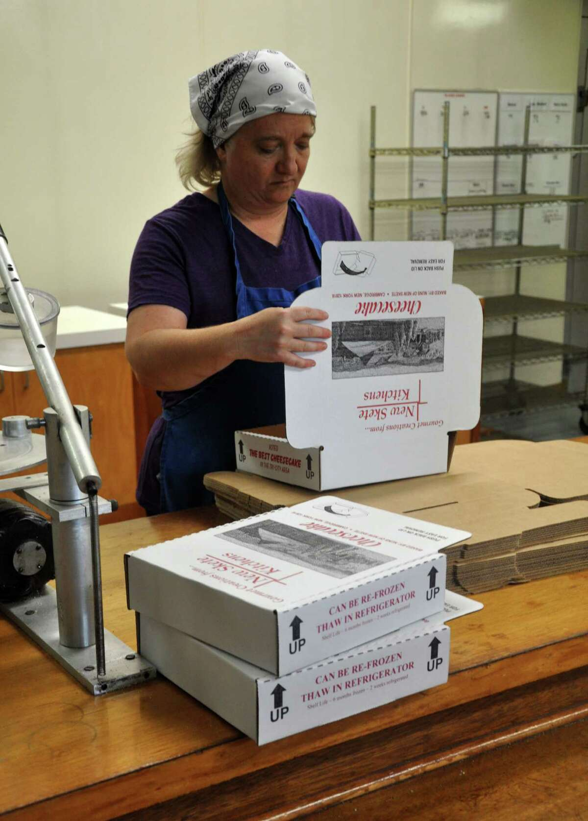 Kate Smith, an employee at the monastery, makes boxes for the cheesecake at New Skete Monastery on Wednesday, Aug. 3, 2016 in Cambridge, N.Y. The monastery will soon be celebrating its 50th anniversary. (Eliza Mineaux/Special to the Times Union)