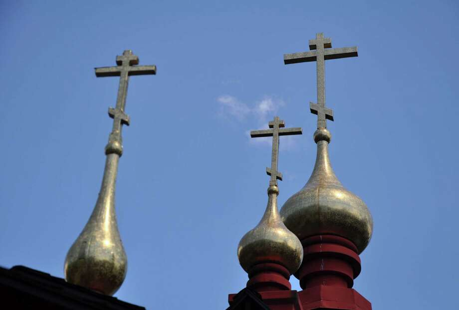 Crosses on top of the Holy Transfiguration Temple at New Skete Monastery on Wednesday, Aug. 3, 2016 in Cambridge, N.Y.  Photo: Eliza Mineaux / 20037540A